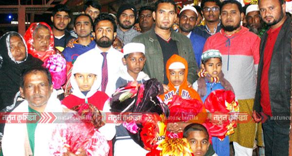 কুমিল্লা ন্যাশনাল ক্লাবের শীতবস্ত্র বিতরণ ও পিঠা উৎসব